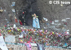 Virgin of Lourdes and offerings