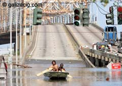 Victims of the Katrina in New Orleans try to live through the floods