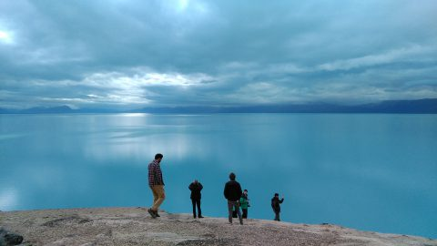 Part of our group, ecstatic staring at the immense Lake Argentino.
